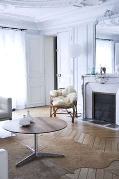 All white with gorgeous details - & amazing chevron wood floors