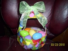 Milk jug Easter basket  Cut out sides of milk jug to make the handle.  Then covered the basket with multicolored tissue paper with modge podge