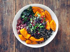 autumn bounty bowl: wild rice, kuri squash, coconut oil, swiss chard, pinto beans, micro greens, pom seeds + miso tahini maple sauce