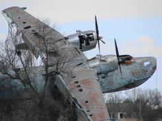 "Ukraine, Mymyi - a Beriev sea-plane converted to a monument. NATO nickname was ""Madge"". First flight from water was made A twin-engined patrol flying boat, It stayed in service until the late Abandoned Cars, Abandoned Buildings, Abandoned Places, Abandoned Vehicles, Abandoned Ships, Ukraine, Sea Plane, Old Planes, Rust In Peace"