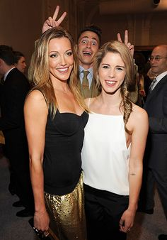 Colton Haynes photobombed Katie Cassidy and Emily Bett Rickards, giving them some complimentary bunny ears at the 2014 CW Upfronts in NYC on May 15