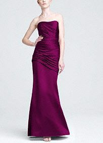 """Dare to be""""Red Carpet"""" readyat any special event in this satinstunner!  This lovelysatin strapless dress featurespleated gathering at the bustthatisultra chic.  Side ruching that flows into the fit and flare silhouettegives you aflawless andcaptivating look.  Fully Lined. Back zip.Imported polyester. Dry Clean Only."""