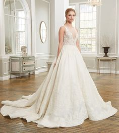 Robyn | Sleeveless lace bateau neck bodice with full ball gown circle skirt with appliqued floral scroll lace in peaked motif
