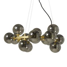 Gold Metal and Black Tinted Glass Pendant on Maisons du Monde. Take your pick from our furniture and accessories and be inspired! Industrial Pendant Lights, Pendant Lighting, Metal Shelving Units, Lustre Metal, Luminaire Vintage, Globe Lamps, Parasols, Kitchen Family Rooms, Metal Chandelier