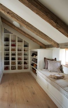 Clever Attic Storage IdeasAttic Closet Ideas - Walk-in attic wardrobe includes a sloped ceiling lined with rustic timber light beams over angled built in footwear cubbies and sweatshirt racks beside a window seat. Bedroom Decor Design, House, Home, Attic Master Bedroom, Storage Spaces, Bedroom Loft, Bedroom Furniture, Small Bedroom, Loft Conversion Bedroom