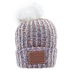 a0c77bf1173 This pom beanie is knit from cotton yarn in navy
