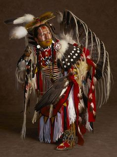"""I dance to give thanks to Great Grandfather for giving us wonderful things–songs and dances, animals, birds, creatures, and insects; trees and plants and all human beings,"""" says Fabian Fontenelle, a powwow dancer of Omaha and Zuni descent"""