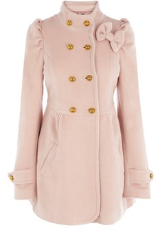 This funnel neck coat has double breasted buttons down the front and bow detailing to the neck. With full length sleeves and pockets to the front this is perfect for covering up in the cooler weather.