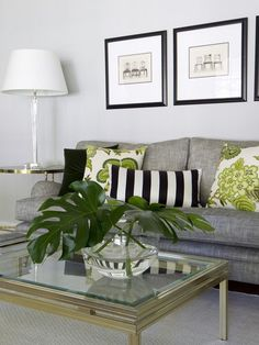 Painting a room white or a very pale grey leaves the option to accessorize with multiple colours, without feeling too busy. The black, white and green pillows stand out thanks to the neutral background.