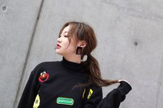 Graphic sweatshirts are a comfortable, low-maintenance way to really embrace your personal style. #refinery29 http://www.refinery29.uk/2016/03/107068/korean-fashion-seoul-street-style-photos#slide-19