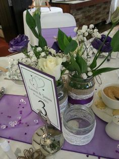 Homemade jar table decorations #wedding #purple