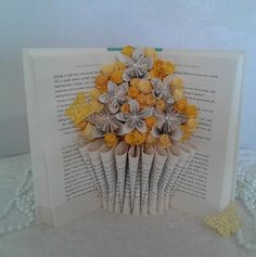 Check out this item in my Etsy shop https://www.etsy.com/listing/600809211/book-sculpture-altered-book-book-bouquet