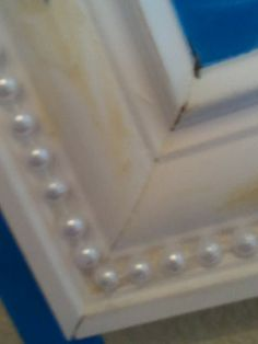 Add pearl garland to a regular frame, then paint over it.