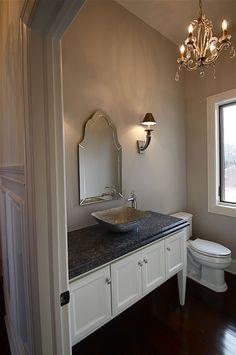 Elegant powder room with chandelier, floating sink, custom vanity by Arrow Millwork and Cabinetry in Greendale, WI