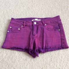 Colored denim shorts It's a mix of purple and pink and they are cutoff shorts. They are basically new and are low waisted, Forever 21 Jeans