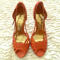 Strappy orange heels Strappy orange heels by bakers! Great condition, minor wear pictured on the back of the heels. Heel is 3.5 inches, leather upper Bakers Shoes Heels
