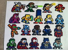 Medium perler bead sprites Megaman style ( the Simpsons, Megaman, PSY, Hulk, Superman, and more) $3 each.  We can custom make any character of your choice.  These are fun!  Great Christmas ornaments, magnets, or deco. OutOfTheParkArt @Etsy.com