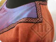 One of a kind Viking dress made of naturally dyed wool with diamond twill pattern. The neckline and cuffs are decorated with pieces of blue silk with a red glow and a tablet woven silk band. The wool is very delicate and soft, which will make it a perfect dress for Summer :)  The dress is sewn together on a machine and then all the seams are finished by hand, so it looks hand-made on the outside, as well as on the inside.  Lenght: 148cm (will be perfect for someone 166-172cm of height)…