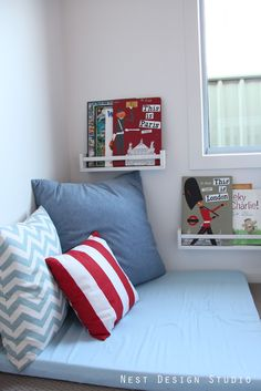 Book racks above bed. My son is always falling asleep surrounded by books in his bed.