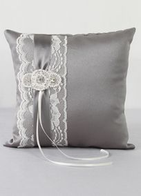 "Trimmed with delicate lace and layered with satin ribbon, this ring bearer pillow has the perfect vintage charm while incorporating your David's Bridal exclusive wedding colors. Embellished with a faux pearl bead and rhinestone applique, this pillow is the perfect compliment for your wedding day.  Features and Facts:   Size: 8"" square  Made of satin and lace with faux pearls and rhinestones"