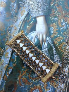 Love this artist's jewelry--she has a fascinating history viewed on her Etsy shop site.  Genuine Antique Gold (old gold tone) Passementerie Trim Ribbon Bracelet, intricate lace design embellished with vintage stones