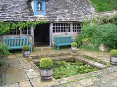 Turquoise benches and flagstone hardscape AND lily pond.