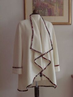 I have just made up this jacket with a Kwik Sew pattern 3977. I used a boiled wool and edged it with a print fabric. I also added cuffs to the sleeves and edged them. The back neck seam of the...