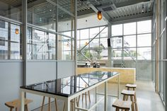 Blue Bottle Coffee Kiyosumi-Shirakawa is a minimalist house located in Tokyo, Japan, designed by Schemata Architects. The former storage building had no windows, so the architects made a large skylight in the center to distribute natural light throughout the space on the second floor. (4)