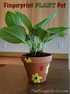 Fingerprint Plant and Flower Pots! {these make fun gifts from the kids!} ~ at TheFrugalGirls.com #fingerprints #plants #pots