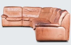 Fabulous Modular curved sofa by De Sede. The light tan leather has such a unique patina and gives this piece tonnes of character.