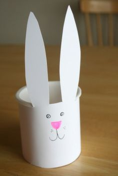 Homemade Easter Bunny Basket- bunnies freak me out but the students would like making this haha