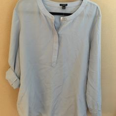 ANN TAYLOR Silk Sky Blue Blouse Ann Taylor, NWT, Size: XL, 100% silk, light-weight, buckle sleeves. Looks and feels great, especially for the office or semi-formal occasion. Ann Taylor Tops Blouses