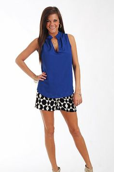 """This top is great for layering or wearing all by itself! The royal blue color never goes out of style and the small ruffle at the neckline adds girly detail. Just add shorts or colored skinnies!   Fits true to size. Miranda is wearing the small.   From shoulder to hem:  Small - 24""""  Medium - 25""""  Large - 26"""""""