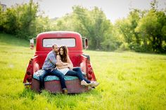 It's cuddle time for this engaged couple in old truck during their engagement photos at sunset at the family's farm!