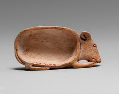 Cosmetic Spoon in the Shape of a Mouse Period: New Kingdom, ca. 1550–1295 B.C. - Bone