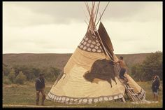 'Setting up Yellow Buffalo tipi' ~ (Blackfeet) ~ Two Medicine River, Montana 1972