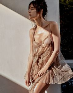 Flaunting some serious skin, Alessandra Ambrosio poses in Haider Ackermann dress