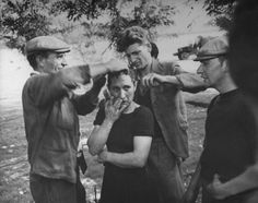 A French woman's head is shaved as punishment for consorting w/ German officer during #WWII