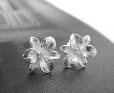 This listing is for a a pair of sterling camellia studs. These are near perfect earrings. Size of studs - x (the dark spots on the earrings are only light reflection from the camera) Earrings Handmade, Handmade Jewelry, Unusual Jewelry, Sterling Silver Earrings Studs, Stud Earrings, Etsy Jewelry, Jewelry Shop, Jewelry Accessories, Jewelry Making