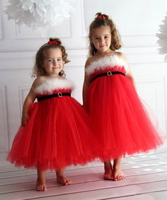 The jolly spirit of Santa is perfectly conveyed in this one-of-a-kind tutu dress; it's perfect for those holiday photos! Made of many layers of puffy and soft tulle, it comes with a red underskirt for extra comfort. TulleSpot cleanImported