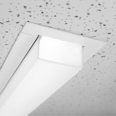 """WAKE BSS420; Versatile, recessed linear LED luminaire with 2"""" wide aperture.  Single and continuous run fixtures are available for installation in common grid ceilings or in walls and ceilings with flange and trimless variants. Flush or 1"""" drop frosted acrylic lens options are offered for all mounting configurations • TPL LIGHTING • MERGING LIGHTING WITH DESIGN • TPLLIGHTING.COM • TORONTO, CANADA •"""
