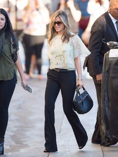 Pin for Later: 28 Style Lessons You'll Thank Jennifer Aniston For Black pants are an essential. You can wear them with anything!