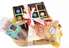 Holi in a basket with chocolates,  Herbal gulaal color each and dry fruits