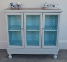 Give an old, ugly cabinet new life with fresh paint, chicken wire, and some cool knobs. -- ALS Auction Cabinet: The Lovely Residence