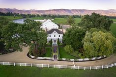 The original Queen Anne-style farmhouse, surrounded by state-of-the-art winemaking facilities and the stunning Sullenger Vineyard.