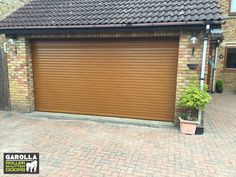 At Garolla, we have a variety of Roller Shutter Garage Door colours available. Our Oak Garage Doors are incredibly stylish and have a traditional appearance. Click below to see our Roller Garage Doors prices fitted online. Garage Door Colors, Garage Walls, Roller Doors, Roller Shutters, Single Garage Door, Garage Doors Prices, Electric Rollers, Garage Extension, Door Quotes