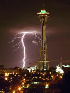 Seattle Space Needle turns 50! Lightning strikes west of the Space Needle on Aug. 4, 1999, during a thunderstorm that rolled through the Seattle Puget Sound area.