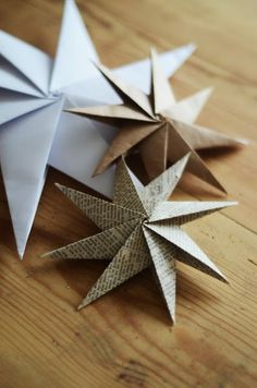 Create origami paper star ornaments.