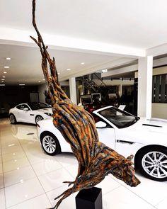 Janko de Beer - Feline in motion sculpture - Jaguar Showroom Stellenbosch Jaguar Showroom, South African Artists, Natural Shapes, Sculpting, Sculptures, Beer, Hair Styles, Root Beer, Hair Plait Styles
