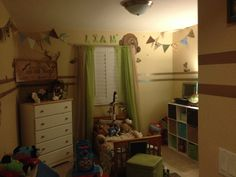 Liam's woodland theme room with some restickable decals, colored duct tape and scrap book paper bunting!!